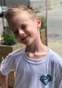 Boy wearting gray Truest Heart T-shirt